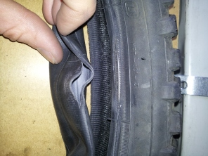 Old tyre with a failed side wall, resulted in inner tube blowing.